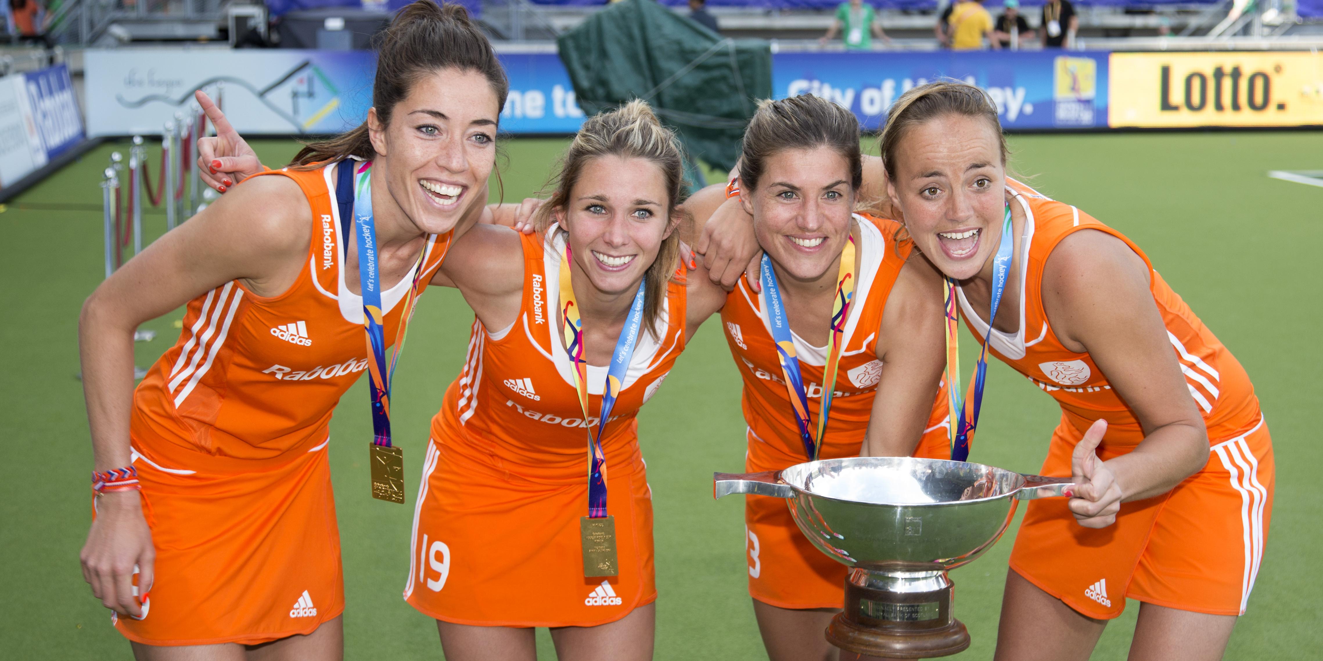 THE HAGUE - Rabobank Hockey World Cup 2014 - 14-06-2014 - WOMEN - FINAL NETHERLANDS - AUSTRALIA 2-0 - DAMES NEDERLAND WERELDKAMPIOEN HOCKEY - NAOMI VAN AS - KIM LAMMERS - ELLEN HOOG EN MAARTJE PAUMEN MET DE WERELDBEKER Copyright: Willem Vernes