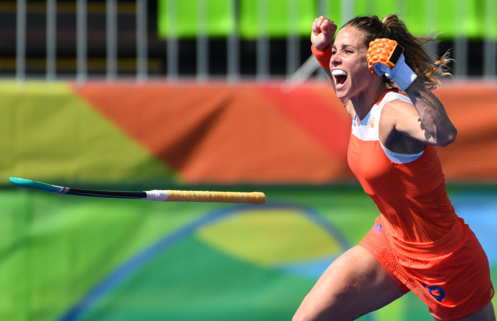 TOPSHOT - Netherlands' Ellen Hoog celebrates her goal during the penalty shoot-out at the end of the the women's semifinal field hockey Netherlands vs Germany match of the Rio 2016 Olympics Games at the Olympic Hockey Centre in Rio de Janeiro on August 17, 2016. / AFP / Pascal GUYOT (Photo credit should read PASCAL GUYOT/AFP/Getty Images)