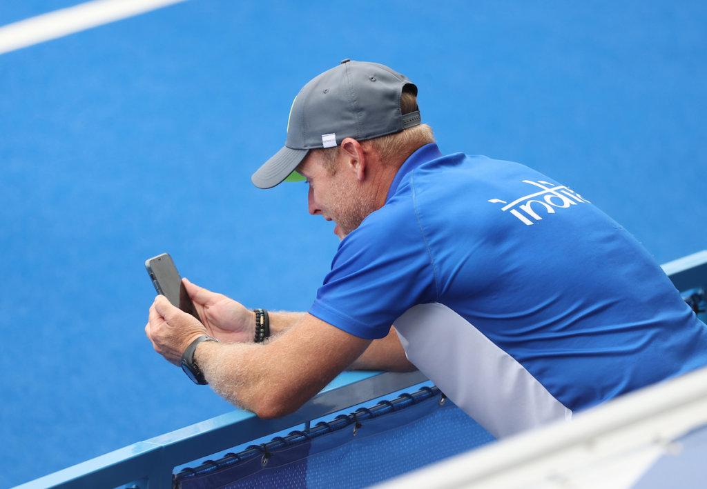 Coach Sjoerd Marijne calls home after india win to reach the semi-finals.Photo: Koen Suyko